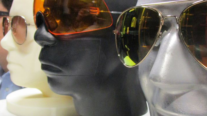 image of heads with coloured glasses