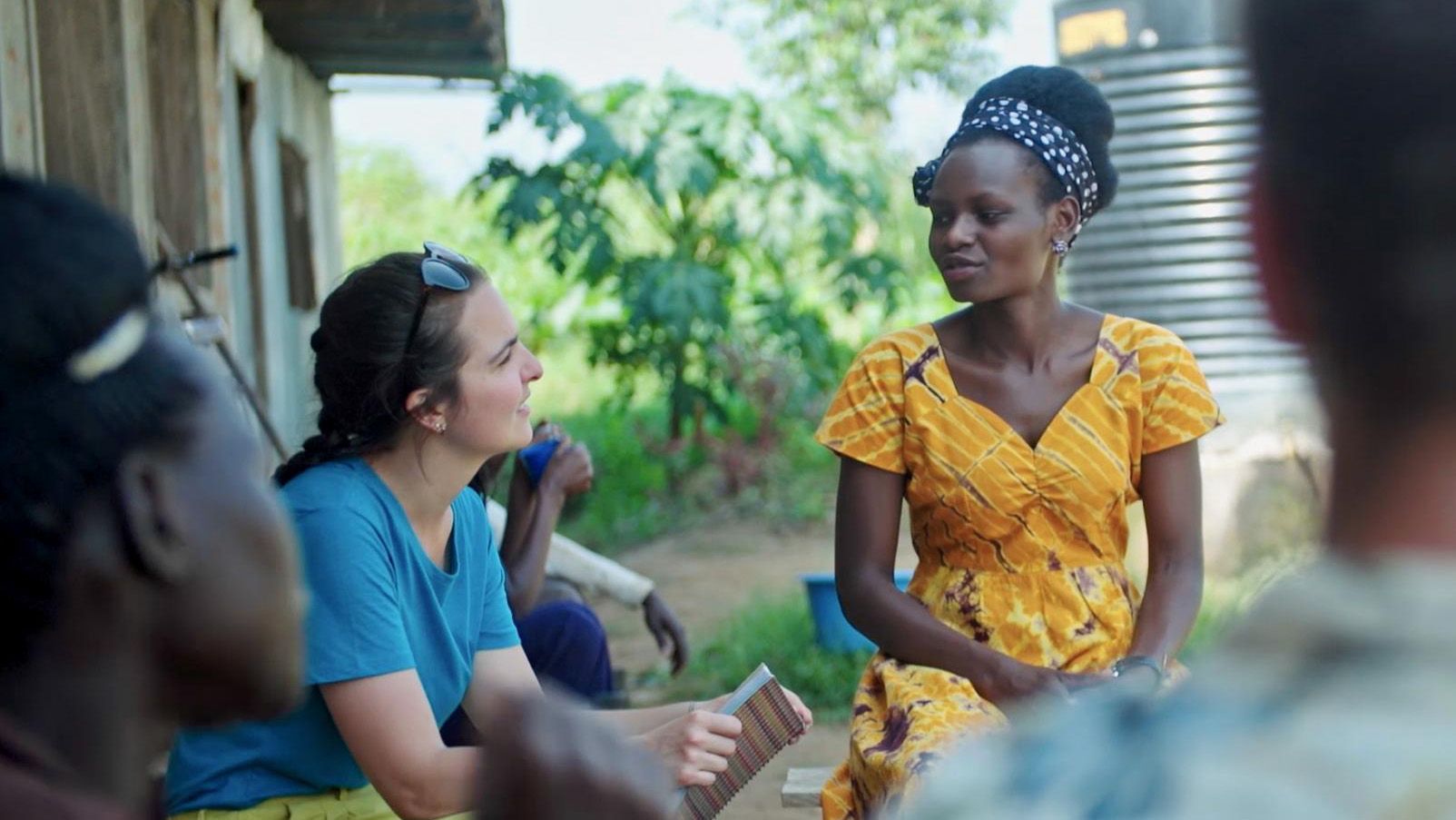 UNSW student talking to a women in Africa