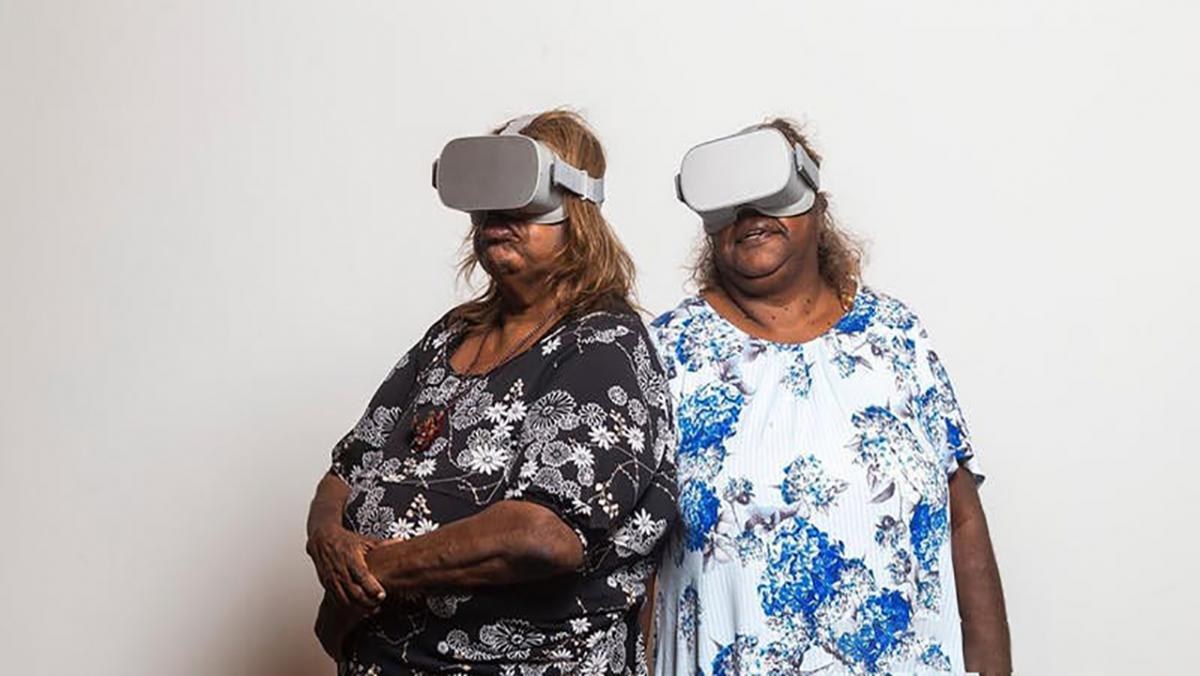 Two women wearing VR goggles