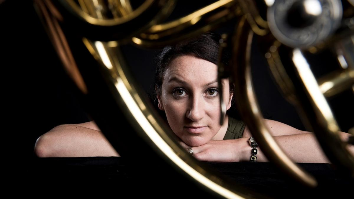 artistic photo of Carla Blackwood looking through a horn